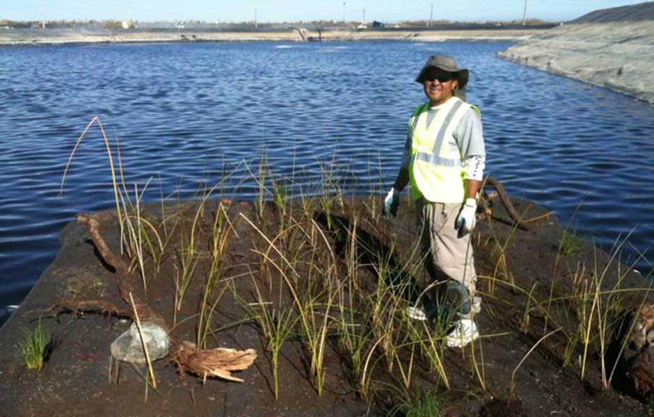 Carlos Lopez builds out floaitng islands for Northern California landfill leachate impoundment