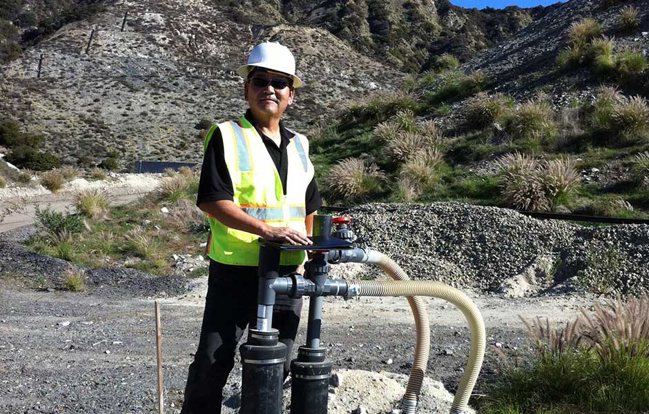 Dennis Hayashi inspecting newly installed landfill gas equipment.